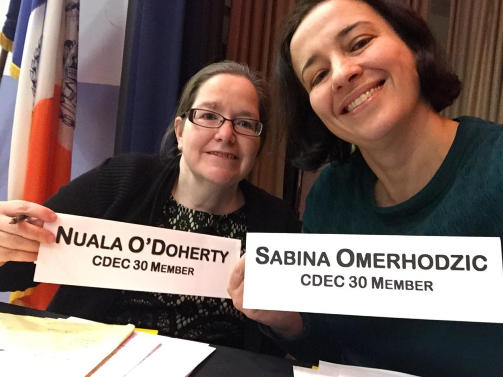 Nuala and Sabina posing with signs that have their names and stating they are CDEC 30 Members